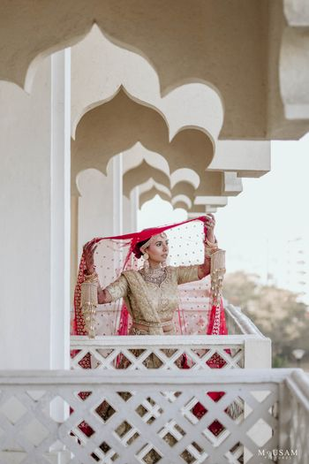 bridal portrait putting her contrasting double dupatta