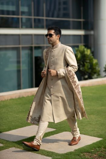 Photo of Groom look with beige sherwani and stole