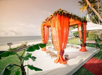 Photo of orange draped mandap