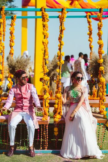 mehendi bridal and groom seating idea with jhoolas
