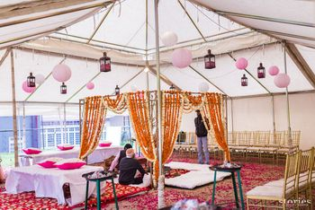 Photo of mandap with hanging pink lanterns