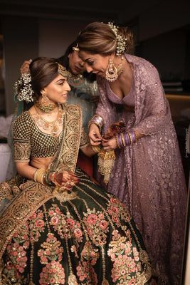 Photo of Bride with sister getting ready