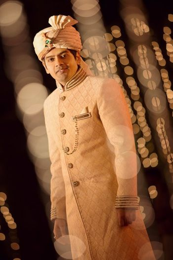 Photo of cream sherwani