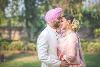 Photo of AngadBedi kisses his bride Neha Dhupia on the forhead