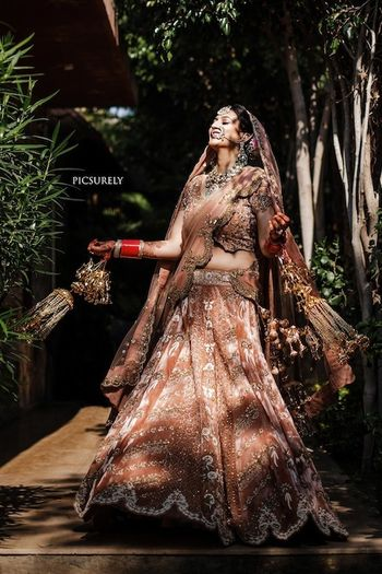 Photo of Offbeat bridal lehenga dusty peach