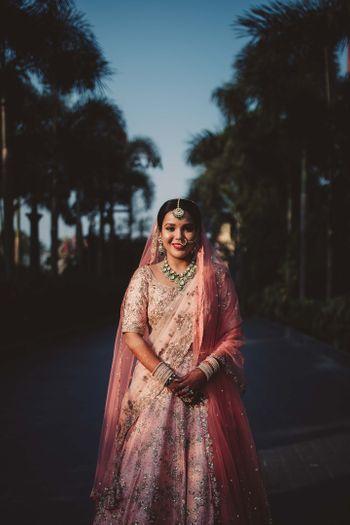 Bride in a pastel lehenga