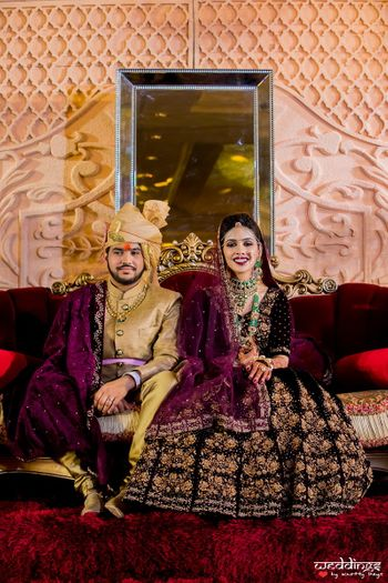 Matching bride and groom in purple velvet lehenga