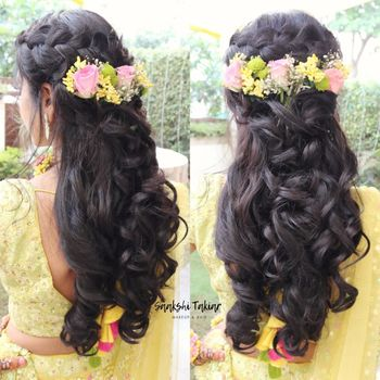 Mehendi open wavy hairstyle with flowers in hair