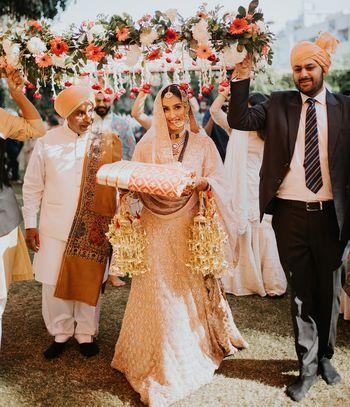 Bridal entry under phoolon ki chaadar