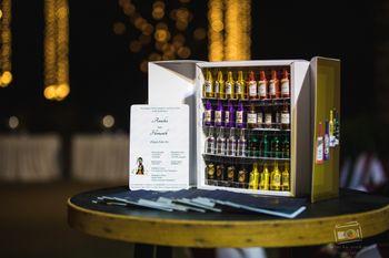 Mini bar fridge decor with small bottles favours