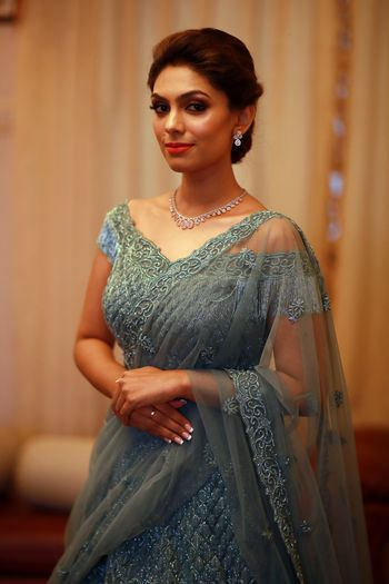 Engagement look with teal net lehenga with off shoulder blouse