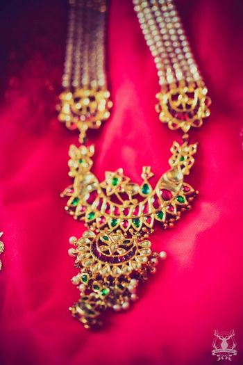 Photo of kundan gold and emerald tukdi with strings
