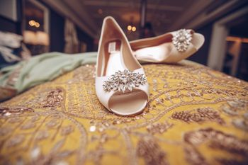 Photo of Off white embellished bridal shoes