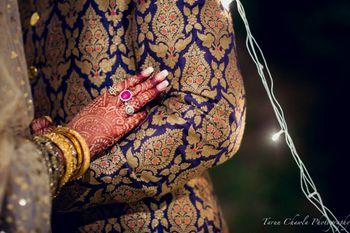 Photo of blue sherwani. blue brocade fabric