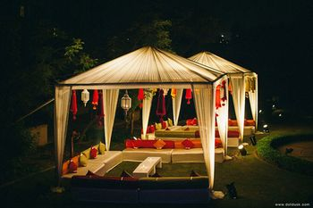 white and red cabana with lanterns