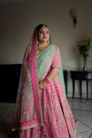 Photo of Punjabi bride in pretty pink lehenga for wedding