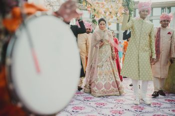 A beautiful bridal entry under a gorgeous phoolon ki chaadar