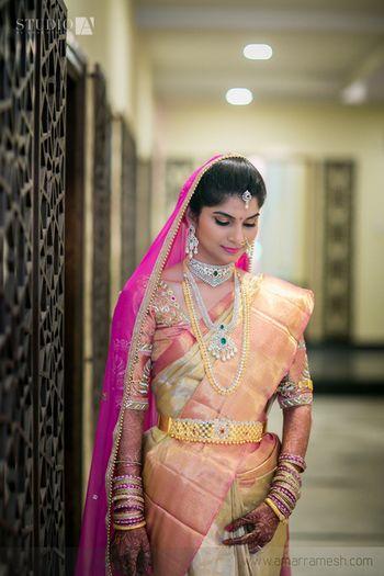 Photo of wedding kanjivaram bridal saree in soft blush pink and gold