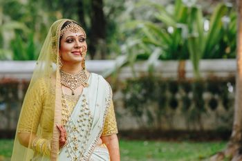 Photo of Bride wearing satlada with offbeat lehenga