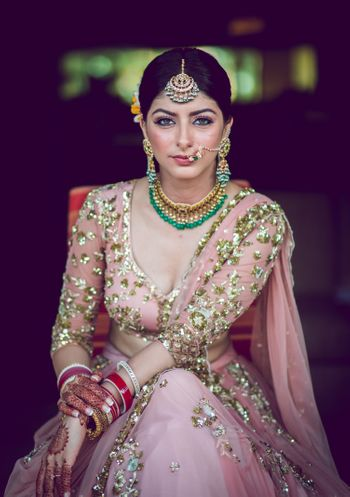 A bride poses for a perfect click before she ties the knot.