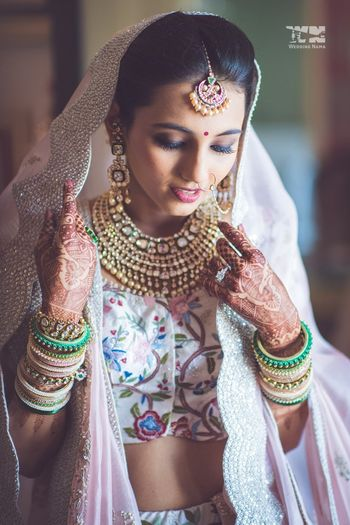 Photo of Bride in white lehenga