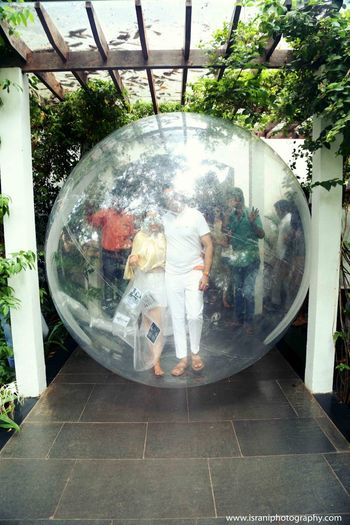 Photo of bride and groom in  zorbing ball