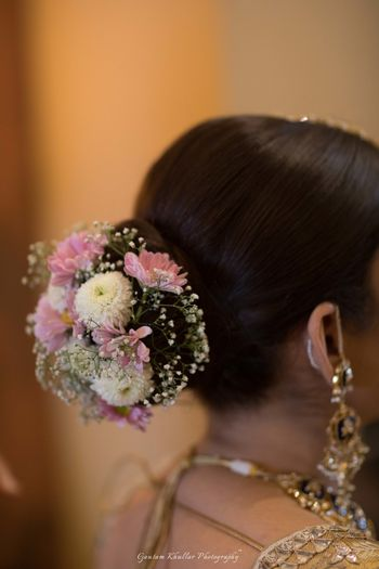 Photo of Bridal bun with small flowers and babys breath