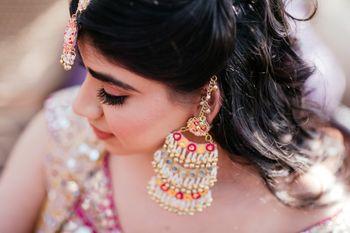Photo of Fun mehendi jewellery with unique earrings