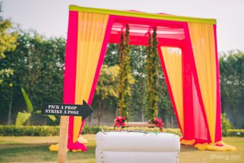 Photo of Orange photobooth backdrop with swing