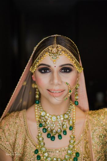 Layered bridal contrasting jewellery with peach makeup