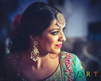 Bride in Turquoise Blouse and Polki Earrings
