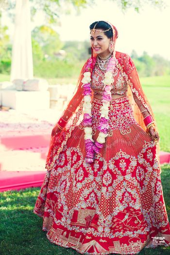 Offbeat red bridal koesch lehenga