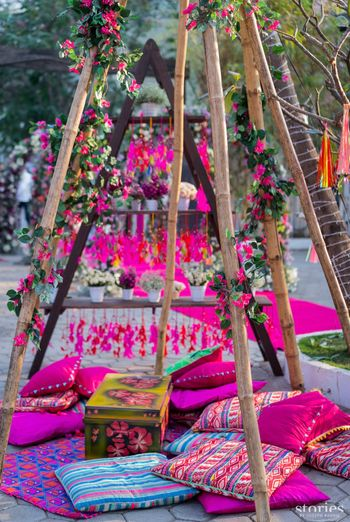 Pretty mehendi decor with floor seating cushions