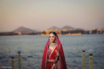 Bride in ruby red lehenga