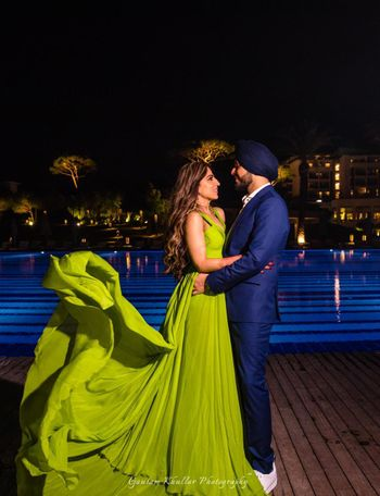 Photo of Green flowing gown engagement photo
