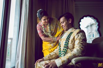 Photo of Groom with his mother wearing a contrasting necklace