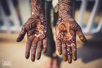 Bridal mehendi with quirky bride and groom portraits