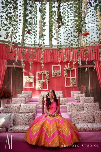 Bright orange and pink lehenga for mehendi