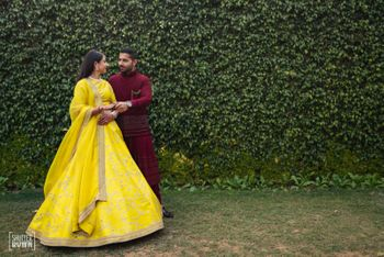 Photo of Bride in bright yellow sabyasachi lehenga