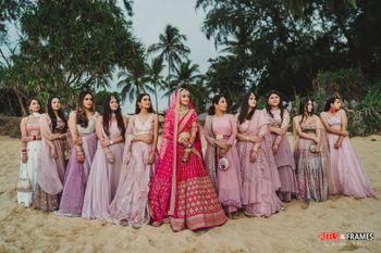 Photo of Bride with coordinated bridesmaids on wedding day