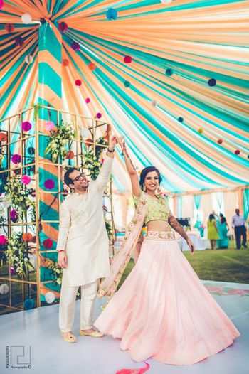 Dancing couple shot on mehendi