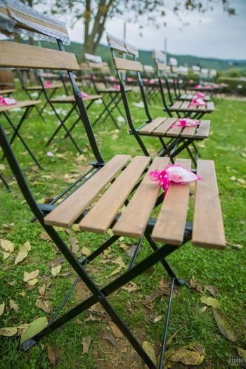 Chairs with petals for guests to throw