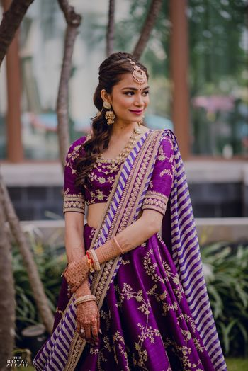 A bride in purple sabyasachi lehenga for her mehendi