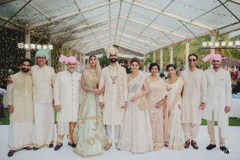 Coordinated family in pastel wedding photo