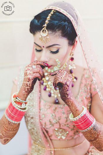 Bride adjusting nosering