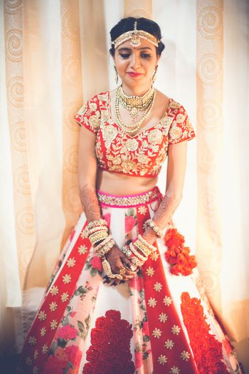Unique red and white bridal lehenga with panels