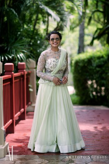 Light green lehenga with unique blouse for sister of the bride
