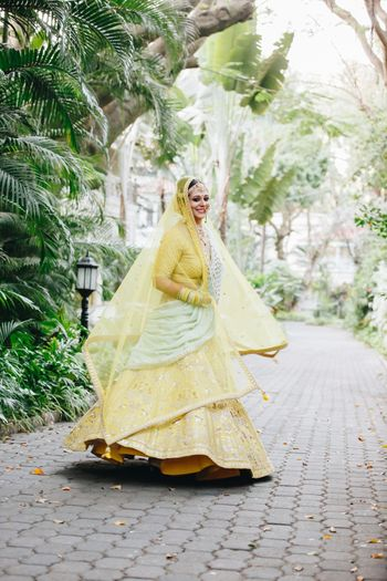 Unique bridal lehenga in yellow and mint