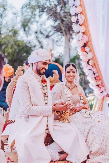 Photo of intimate wedding couple matching the decor