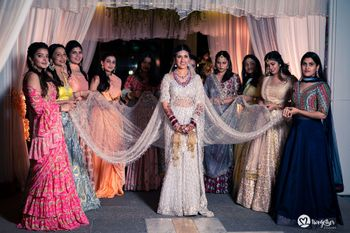 Photo of bride entering with the bridesmaids
